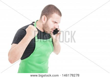 Angry Supermarket Employee Yelling At Telephone