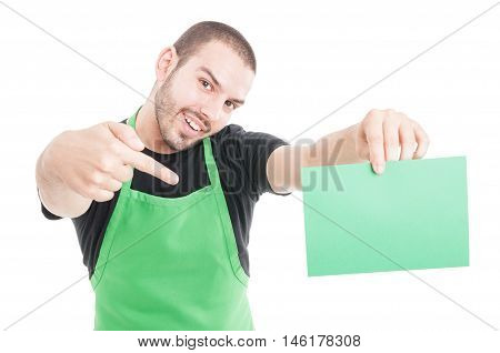 Market Employee Pointing Green Cardboard And Smiling