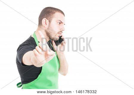 Supermarket Seller Making Refuse Gesture While Phone Speaking
