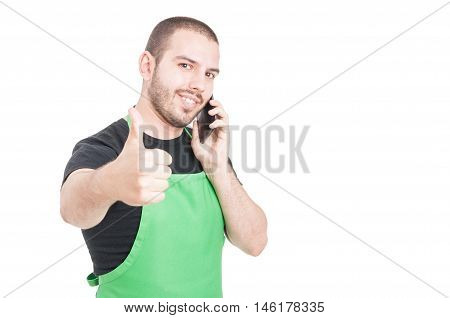 Attractive Market Seller Making Like Gesture At Phone