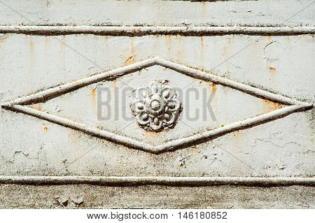 Rusty iron door with rosette as background