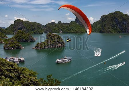 HA LONG, Quang Ninh, Vietnam, August 24, 2016 Ha Long Bay, Quang Ninh, Vietnam the world's natural heritage. tourists paragliding, sports and entertainment