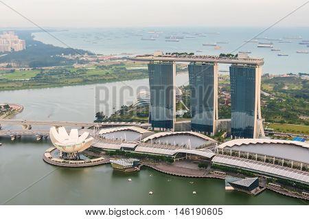 SINGAPORE, REPUBLIC OF SINGAPORE - JANUARY 08, 2014: Singapore city skyline. Aerial view of Marina bay