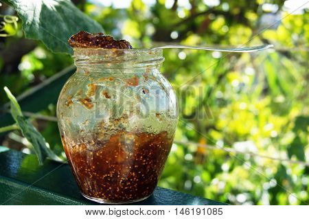 Half-filled small jar with sweet fig jam