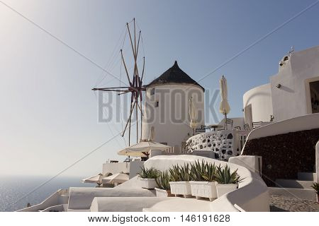 Windmill Of Oia Town At Sunny Day, Santorini