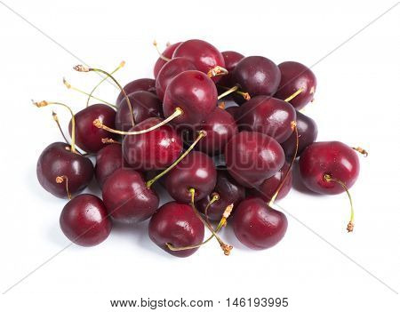 Heap of cherries isolated on white background