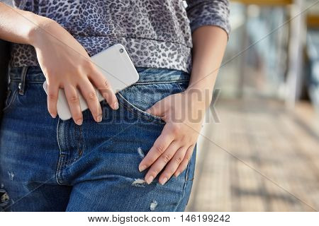 Woman Holding Modern Smart Phone In Hand