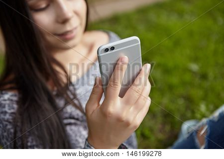 White Girl Using Modern Dual Camera Smart Phone