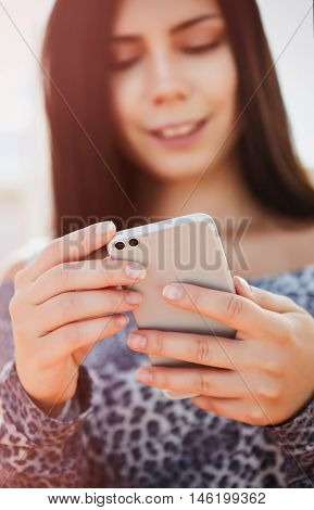 Young Pretty Model Using Modern Dual Camera Smart Phone
