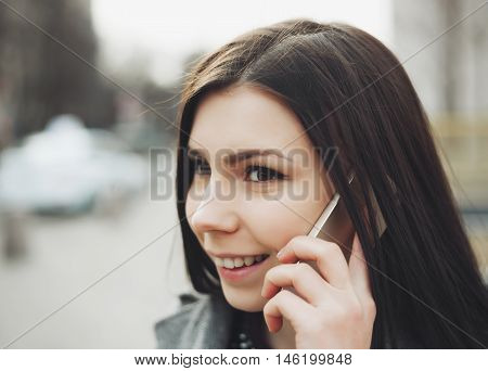 Young Pretty Brunette Girl Talking On The Phone