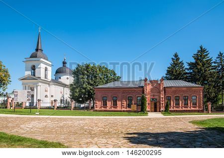 Baturin Ukraine - August 29 2016: Museum of Archaeology and Orthodox Church of the Ascension (1803) on the left in Baturin Ukraine.
