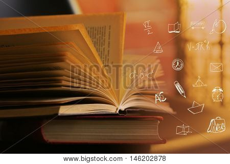 Book with icons, closeup. Blurred background.