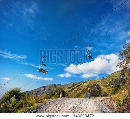 Tourist Woman In The Mountain Ski Resort