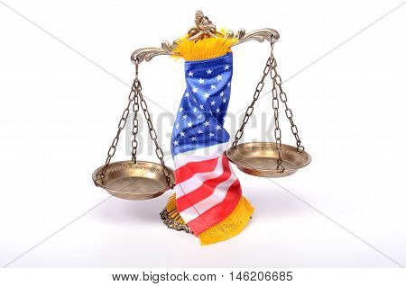 Scales of justice rolled up with American flag law and justice concept.