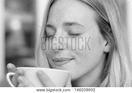 Happy Young Woman Enjoying Her Morning Coffee