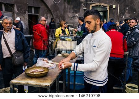 Catania, Fisherman Slaughter The Fish For Sale Fish Market