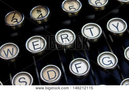Detail of vintage style lettered keys from an old antique typewriter.