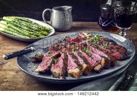 Wagyu T-Bone Steak with Green Asparagus on Plate