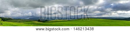 panoramic picture of mountain plateau on the background of the cloudy sky