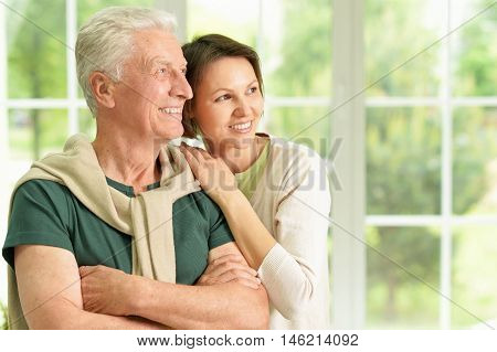 Happy senior father  with daughter at home