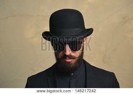 English modern Man with Bowler Hat, Beard and Mustaches