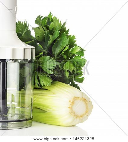 Blender stems and leaves of celery for green smoothies salad isolated on white background healthy eating concept