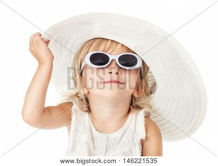 Caucasian little sweet girl 2 years old in white hat dress and sunglasses isolated on white background hand holding his hat