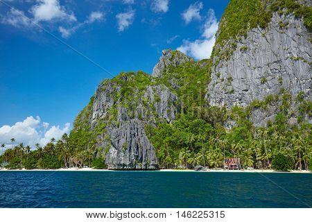Beautiful island. Blue bay and palm trees. El Nido, Palawan, Philippines