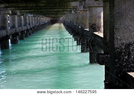 Under surface of bridge on sea at Bhet Dwarka off Dwaraka Coast in Gujarath India Asia