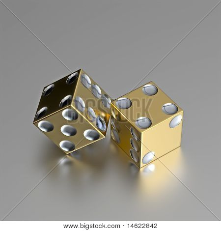 Golden right handed casino dice with silver eyes