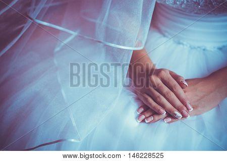 wedding manicure. bride in the white dress