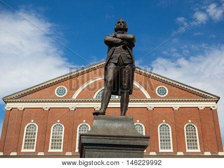 BOSTON,MASSACHUSETTS,USA - JULY 15,2016: Statue of Revolutionary Patriot Samuel Adams 1722-1803 in front of historic Faneuil Hall Boston MA
