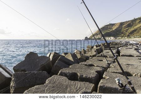 View First Breakwater Floor With Fishing Rods, Italy