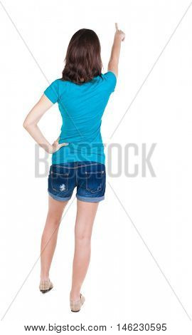 Back view of  pointing woman. beautiful brunette  girl in shorts. Rear view people collection.  backside view of person.  Isolated over white background.