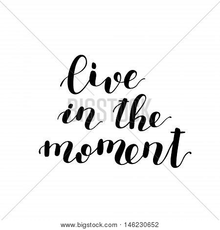 Live in the moment. Brush hand lettering. Inspiring quote. Motivating modern calligraphy. Can be used for photo overlays, posters, holiday clothes, cards and more.