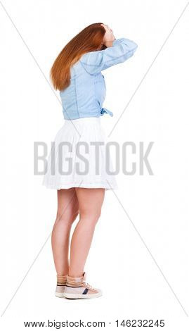 Back view of shocked woman in dress. girl hid his eyes behind his hands.  Rear view people collection.  backside view of person.  Isolated over white background.