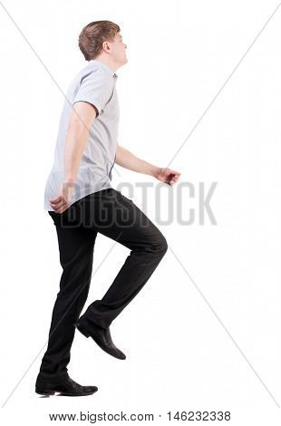 back view of running business man . walking businessman in motion. Rear view people collection.  backside view of person. Isolated over white background. quickly rushes young man in office clothes