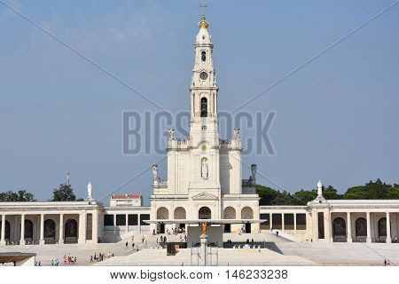 FATIMA, PORTUGAL - AUG 24: Sanctuary of Fatima in Portugal, as seen on Aug 24, 2016. It consists of a tall centralized bell-tower and nave, 213 ft in height, decorated by a 15,000 lb crown of bronze.