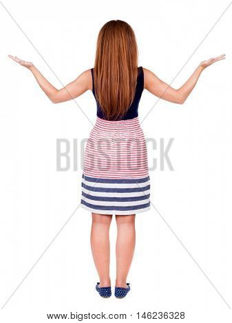 back view of surprised beautiful  redhead young woman with hands up. Girl in blue dress. Rear view people collection.  backside view of person.  Isolated over white background.