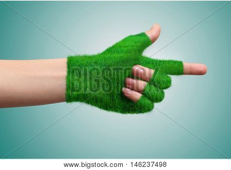 Go Green ConceptHand in glove grass indicates the direction.Ecological concept.