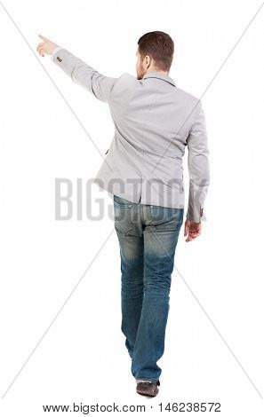 Back view of going business man pointing. walking young guy . man in a gray jacket leaves the frame showing a finger in the side.