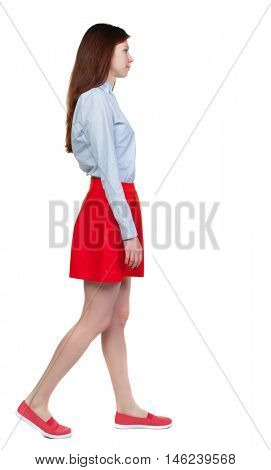 back view of walking woman. beautiful blonde girl in motion. Isolated over white background. Long-haired brunette in red skirt is a sad side.