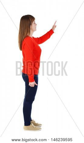 Back view of pointing woman. beautiful girl. Rear view people collection. girl in the red sweater is left side by pressing the index finger on the button.
