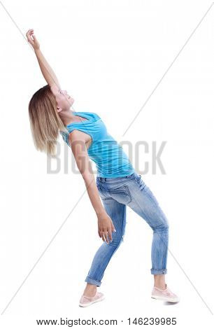Balancing young woman. or dodge falling woman. Rear view people collection. blonde in a blue shirt and jeans leaned back heavily.