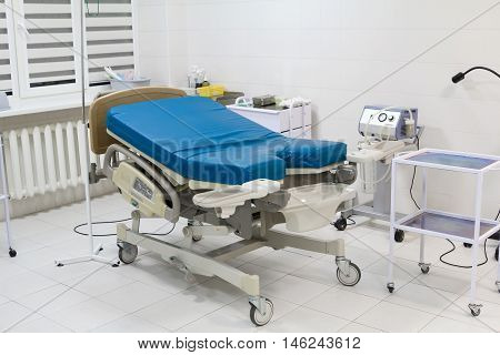 Medical bed in labour room at modern hospital. Delivery room