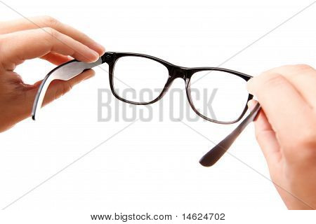 Hands Holding Classic-styled Glasses