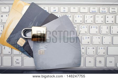 Credit card,book bank,keyboard and plant at brown background topview