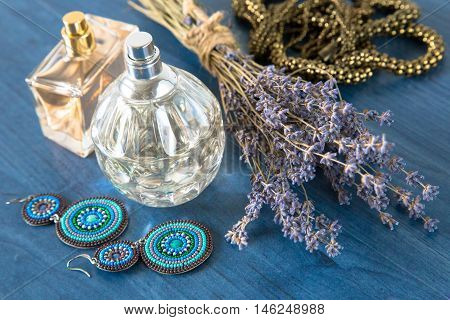 Perfume With A Bouquet Of Lavender And Jewelry