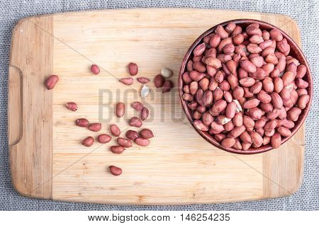 Top View Of A Brown Bowl With Raw Peanuts