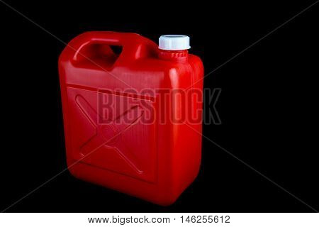 Red fuel container isolated on a black background